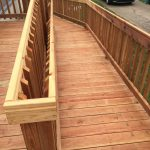 Curved Wooden Ramp Outside Home