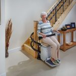 Senior On Handicare 2000 Stairlift