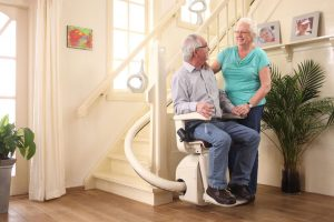 Elderly Man Riding Stair Lift for Curved Stairs