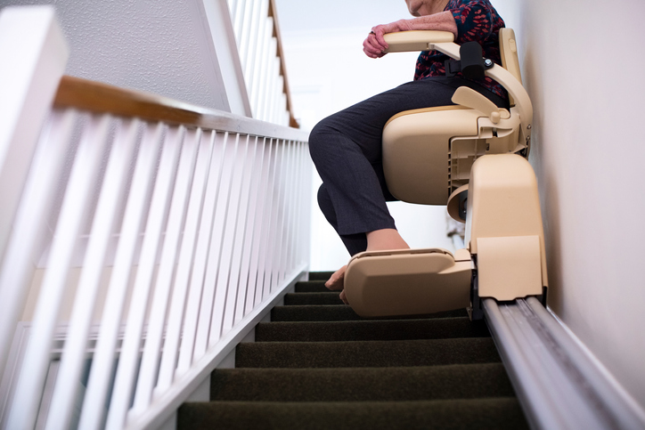 Woman on Stair Lift At Home